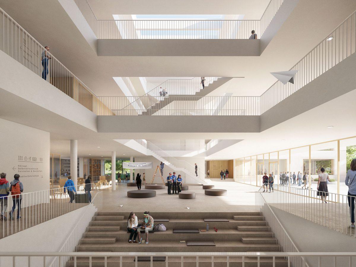 zentrales Forum mit Lufträumen, einläufigen Treppen und Eingangsbereich der Martin-Niemöller-Gesamtschule in Bielefeld.