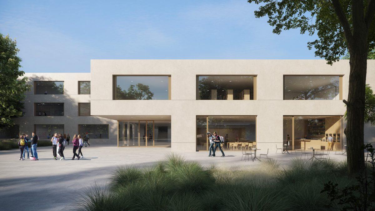 Vorplatz mit zentralem Haupteingang des südlichen Gebäudes der Martin-Niemöller-Gesamtschule in Bielefeld.