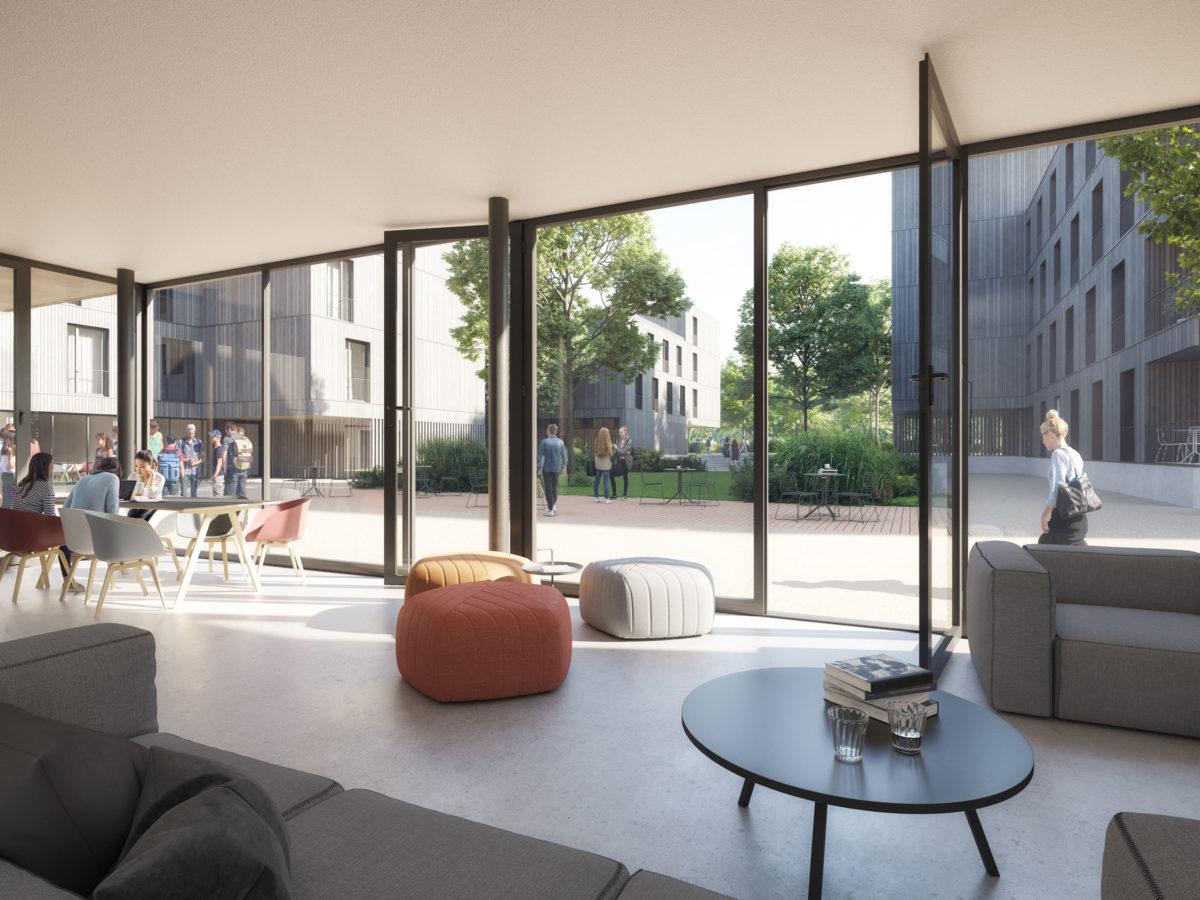 Gemeinschaftsbereich im Erdgeschoss mit Sitzgelegenheiten und Blick in den grünen Innenhof des Studentenwohnheims Avenariusstraße in Nürnberg.
