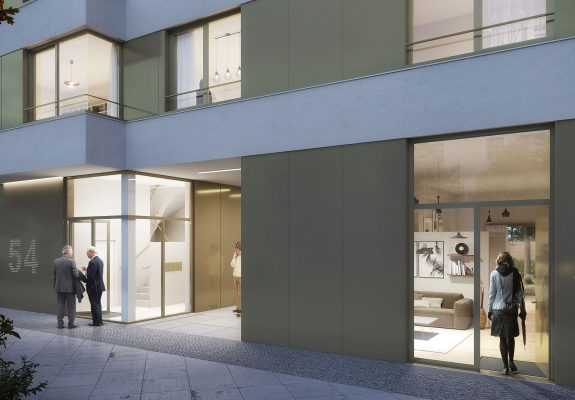 Eingangsbereich des Wohngebäudes mit gebänderter Fassade in Alt Reinickendorf, Berlin.