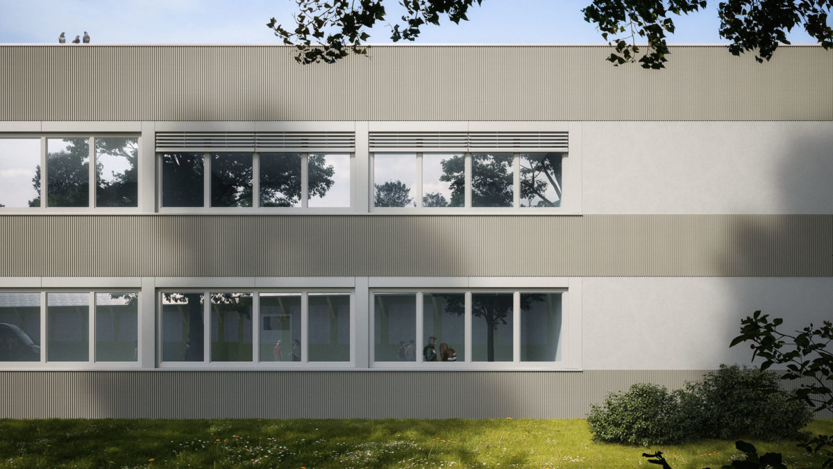 Schulhof mit neuer Fassade der Gustav-Heinemann-Gesamtschule in Mühlheim.