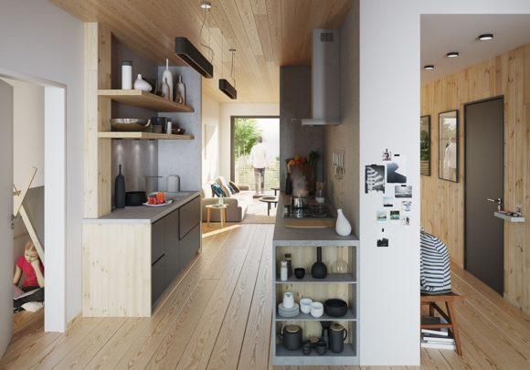 Eingangsbereich mit Küche und Blick in den Garten eines der zwei Wohngebäude, errichtet in Holzsystembauweise, in Berlin Zehlendorf.