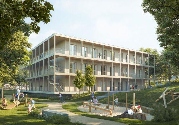 Grüner Schulhof mit dem Neubau der Interimsschule in Essen.