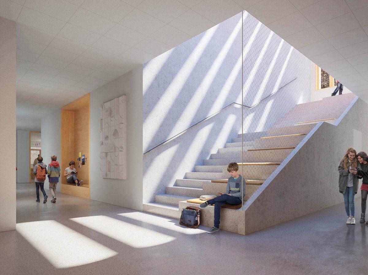 Der Gang und die zentrale Treppe der Modulbauschulen in Köln.