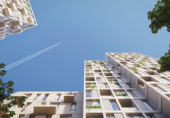Blick nach oben in den Himmel zwischen den Gebäudne im Quartier Theaterplatz in Berlin Hellersdorf.
